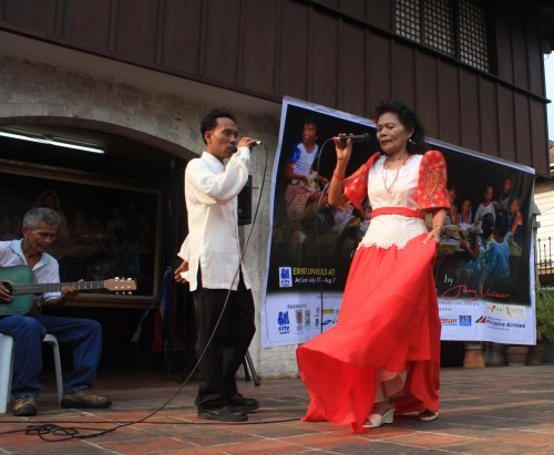Balitaw is a Filipino literary tradition of courtship. In this performance, the woman is convicted to stay home for mama. :)